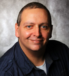 Portraitfoto von Oliver Eckert